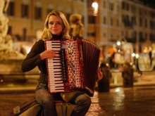 A Russian accordionist playing at the Piazza Navona in Rome, Italy
