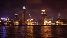 a view of the Puxi skyline at night, across the river from  Pudong,