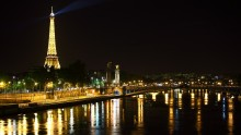 A night view of the Pont Alexandre III and the Eiffel Tower
