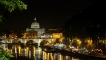 A night view on the Basilica San Pietro across the Tber river